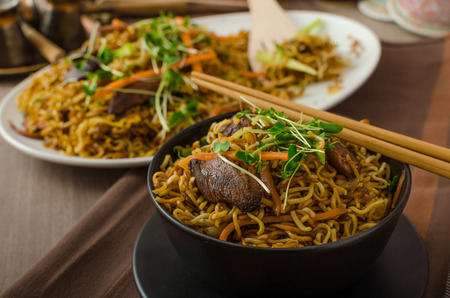 Stir Fry Singapore Noodles, with bio herbs and microgreens, vegetable Reklamní fotografie