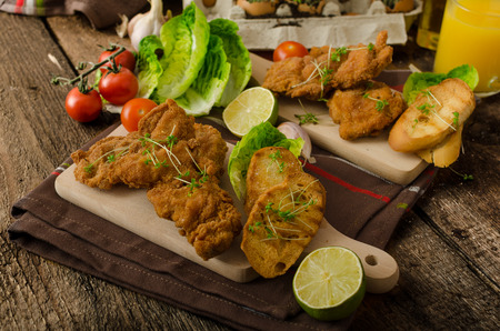 Mini cutlets - schnitzels of chicken legs meat and fresh salad and toasted baguette photo