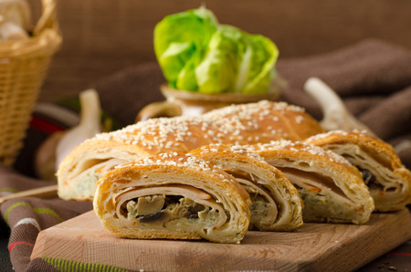 roll out: Roll out puff pastry stuffed with mushrooms, cheese and ham