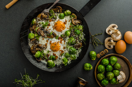Vegetable omelet with bulls eye fried egg, mushrooms and Brussels sprouts