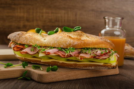 baguette with smoked rump, apples and Emmenthal photo