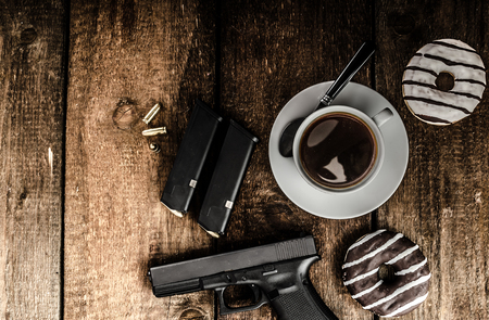 a police officer: American police officer morning, donuts, juice, fresh black coffee and his gun