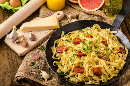 semolina pasta: Semolina pasta with roasted garlic, sprinkled microherbs, fresh and tasty, garlic baked in the oven - delicious