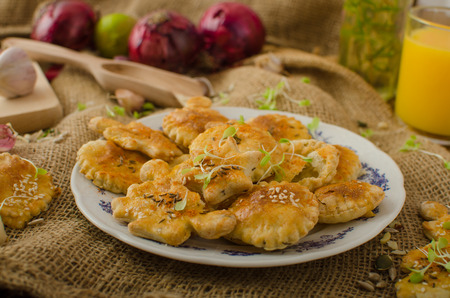 sprinkled: Savory puff pastry - angel, star and balls, sprinkled seeds and cumin, young herbs, fresh orange juice