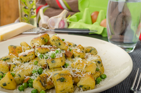 semolina pasta: Homemade Gnocchi with Peas and Parmesan, all organic. Stock Photo