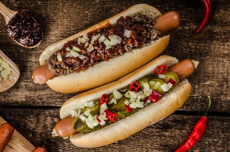 hotdog sandwiches: Chilli and vegetarian hot dog, home pickles, beef meat and homemade barbeque souce Stock Photo