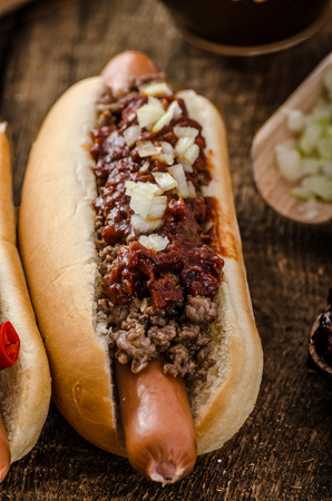 wiener dog: Chilli and vegetarian hot dog, home pickles, beef meat and homemade barbeque souce Stock Photo