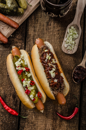 Chilli and vegetarian hot dog, home pickles, beef meat and homemade barbeque souce Stock Photo