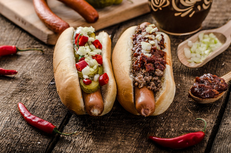 chilli: Chilli and vegetarian hot dog, home pickles, beef meat and homemade barbeque souce Stock Photo