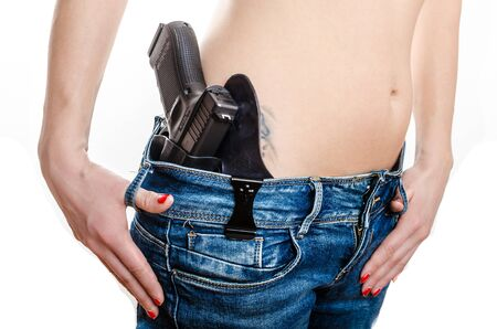 waistband: Concealed carry gun in his waistband, home safety, under law