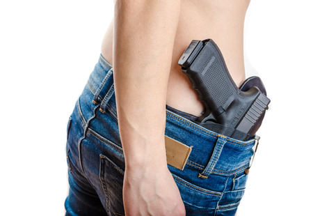 concealed: Concealed carry gun in his waistband, home safety, under law