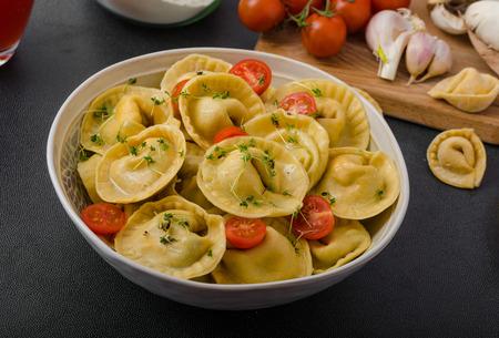 stuffed tortellini: Homemade tortellini stuffed mushrooms and tomatoes with feta cheese