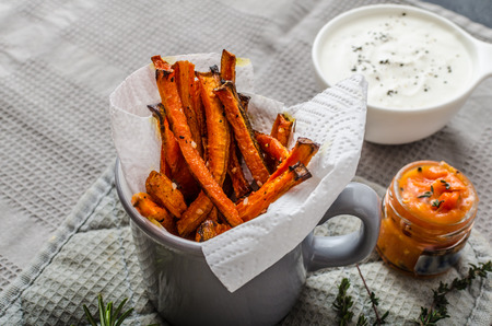 carrot: Healthy vegetable chips - beet, celery and carrots, tomato and garlic dip with herbs, fresh herbs inside Stock Photo