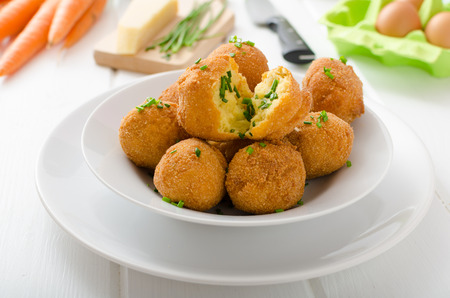 tots: Homemade potato croquettes with parmesan and chives, nice and simple, but delicious light food Stock Photo