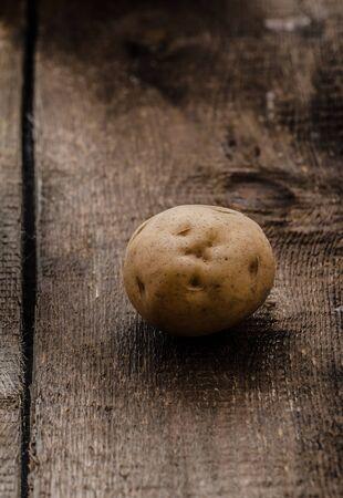 russet potato: Raw potatoes, on wood hard board, prepare for gnocchi