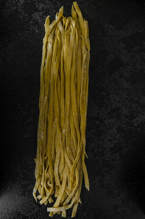 semolina: Homemade pasta, semolina flour, black background Stock Photo