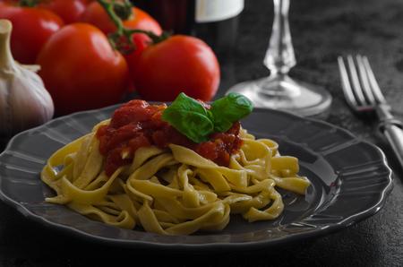 semolina pasta: Semolina pasta with spicy tomato salsa, garlic and basil, Stock Photo