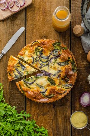 Polenta quiche with red onion, spinach, mozzarella and arugula photo