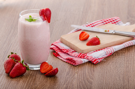 Strawberry smoothie, nice and clean, fresh fruits, leaf of mint