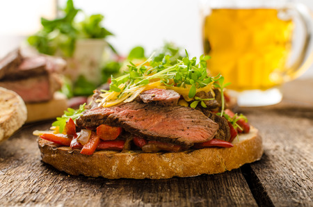 devilish: Devilish fried bread with peppers, chilli and beef steak, topped cheddar cheese and microgreens, with czech beer