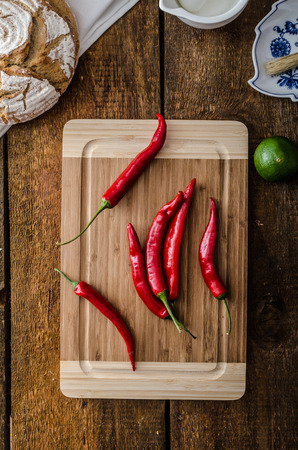 rustical: Chilli peppers raw, homemade bread, lime, simple photo, rustical