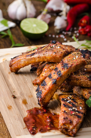 Ribs in spicy marinade with chilli, honey and beer. homemade rustic bread photo