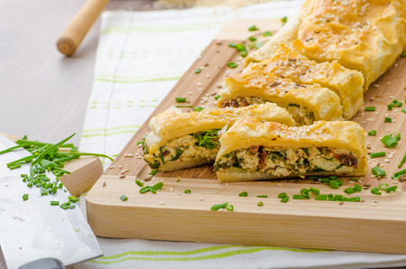 sprinkled: Strudel with spinach, blue cheese and garlic, sprinkled with chive and sesame