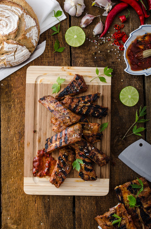 Ribs in spicy marinade with chilli, honey and beer. homemade rustic bread