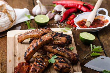 Ribs in spicy marinade with chilli, honey and beer photo