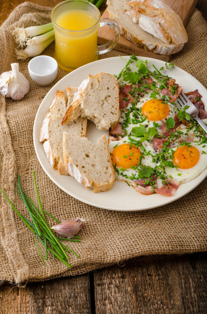 rustical: Spring omelette with bacon, egg and herbs, homemade rustical bread