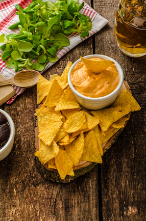 Tortilla chips with cheese dip