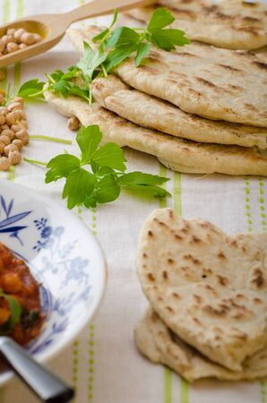 lebanese: Lebanese bread, pita bread, nice and fresh chickpeas in background, simple cheap bread with herbs and garlic