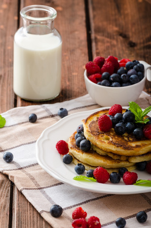 Pancakes with forest fruit and mint, fresh fruits and milk photo