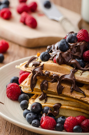 Belgian waffles with fruit and chocolate, forest fruit, all homemade, delicious batter 免版税图像