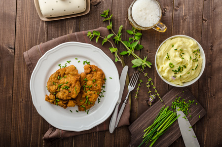 meat dish: Schnitzel with herbs, mashed potatoes and chives Stock Photo