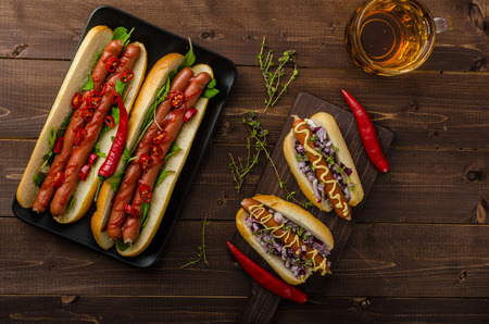 hotdog sandwiches: nice hot dogs with beer