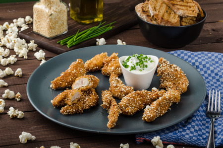 salty: Chicken strips in popcorn breadcrumbs, with delicious garlic dip and panini toast