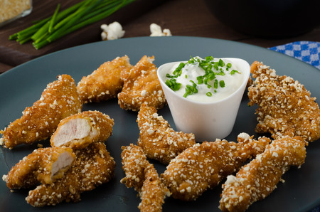breadcrumbs: Chicken strips in popcorn breadcrumbs, with delicious garlic dip and panini toast