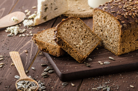 slices of bread: Whole wheat bread with seeds Stock Photo