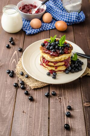 Glutten-free pancakes with jam and blueberries, fresh mint on top Stock Photo
