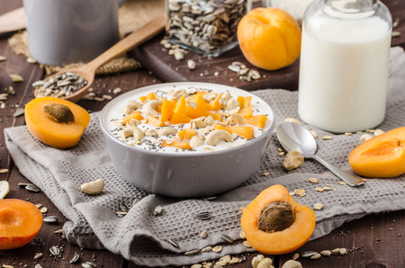 musli: Domestic apricots musli yogurt with milk and crispy nuts and healthy seeds chia Stock Photo