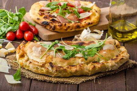 pizza dough: Calzone pizza, filled herbs, cheese and tomatoes