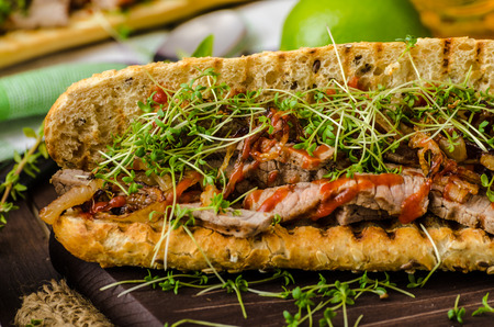 Steak sandwich with herbs, lime and microgreens