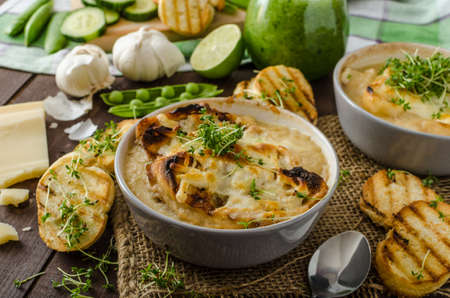 Garlic soup baked toast and cheese, cucumber-peas smoothie, bio organic food, little panini toasts photo