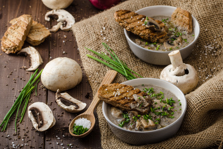 wholegrain: Mushroom soup with chive and herbs, bio healthy whole-grain toast Stock Photo