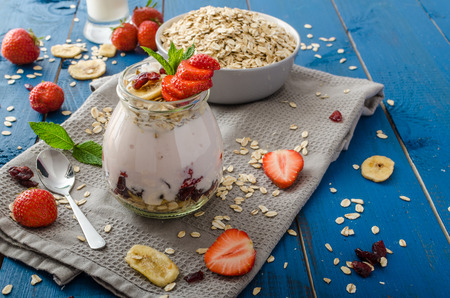 Domestic strawberry yogurt with granola and dried fruit, combination of fresh fruit and granola