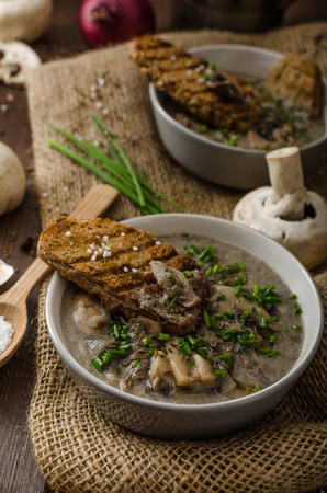 chive: Mushroom soup with chive and herbs, bio healthy whole-grain toast Stock Photo