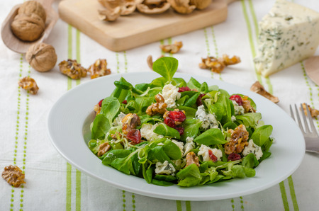Salad with blue cheese and balsamic dressing, with nuts and cranberries