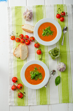 Tomato soup with gremolata, nice and healthy vegetarian food, white bread