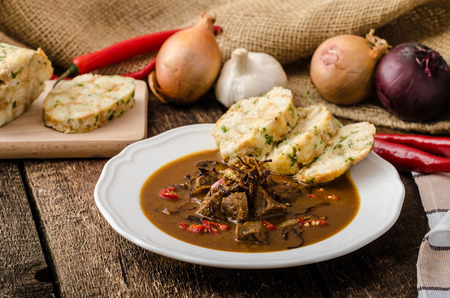 red food: Classic Czech goulash with dumplings, homemade Karlovarsky dumplings Stock Photo